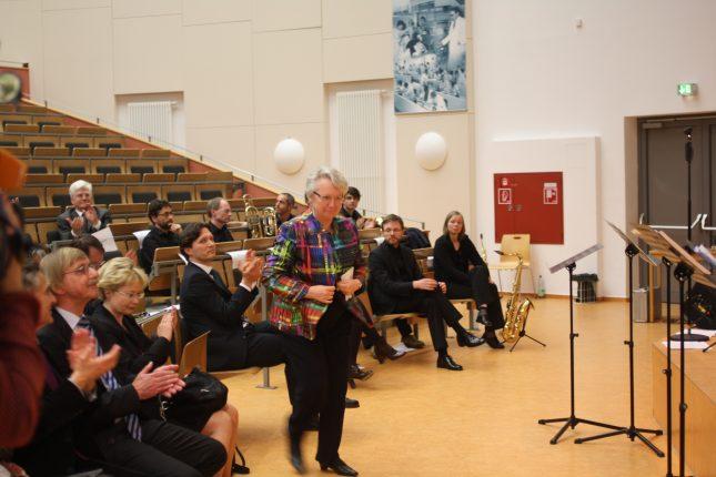 Oliver Grundei (mittig) 2014 beim Jahresempfang der Universität zu Lübeck. In Bunt die ehemalige Ministerin Annette Schavan, im Hintergrund Honorar-Professor Winfried Stöcker.